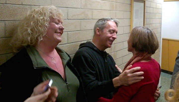 Defendant & 350 Seattle member Abby Brockway with two of the jurors after the trial.