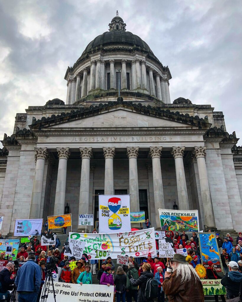 Climate justice activists on the steps of the Washington State Capitol Building