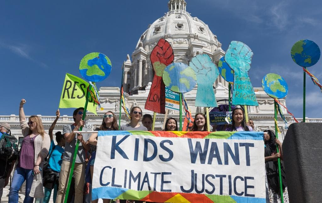 Photo of climate justice protestors on steps of US Capitol